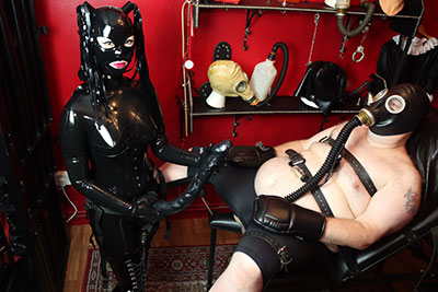 heavy rubber dominatrix if you love to see a gorgeous woman disguising herself in latex hoods Mistress Patricia is your lady